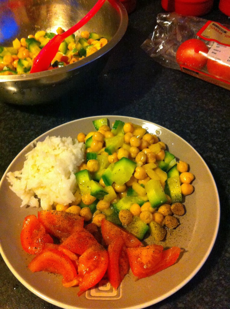 chickpeas & cucumber salad with rice and fresh tomatoes on the side